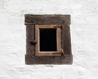 Old window on white wall of house Royalty Free Stock Images