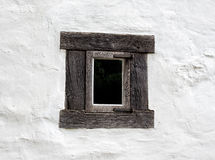 Old window on white wall of a house Royalty Free Stock Photos