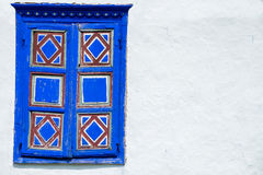 Old window on white wall. Old Romanian traditional window on white wall Stock Images