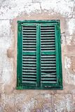 Old window with wind shutter Royalty Free Stock Photo