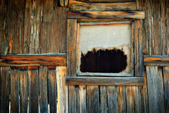 Old window in wooden cabin Stock Photo