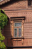 Old window, wooden facade and ivy Stock Photo