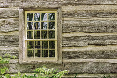 Old window on a wooden farm house wall Stock Photo