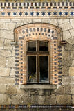 Old window with wooden frame and old stone facade Stock Images