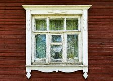 Old window of a wooden house Stock Photos