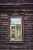 Old window in a wooden house Royalty Free Stock Image