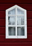 Old window. 1873 wooden red painted white frame glass Royalty Free Stock Images