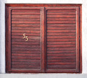 Old window with wooden shutters. And house number Royalty Free Stock Image