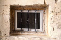 Old window with wrought iron Royalty Free Stock Photo