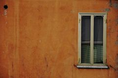Old window on a yellow wall Royalty Free Stock Photos
