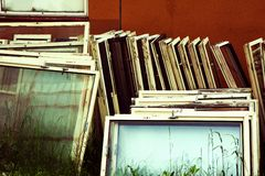 Old windows. Old wooden windows in grass Stock Images