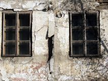 Old windows. Two very old ancient wooden window on the house Royalty Free Stock Photography