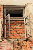 Old windows. The window put in pawn a brick in the old house Stock Image