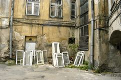 Old windows. Old rotten unused windows in shabby city backyard Royalty Free Stock Photo