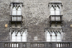 Old windows with balcony Royalty Free Stock Photos