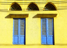 Old windows with blue shutters in stone wall, Jaffa, Tel Aviv Stock Image