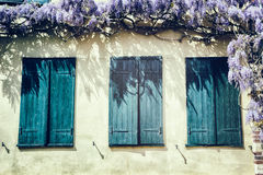 Old windows with blue shutters. Traditional French house Royalty Free Stock Image