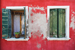 Old windows on colorful houses on Burano Stock Photo