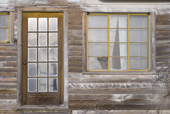 Old Windows and Door. Architectural details of old paned windows and paned door in abandoned, derelict house in Eastern Oregon Royalty Free Stock Photography