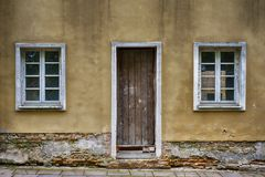 Old windows and door with grunge cracked wall Royalty Free Stock Image