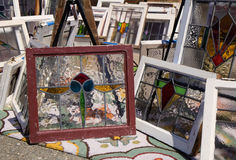 Old windows frames with stained glass at flea market Stock Photo