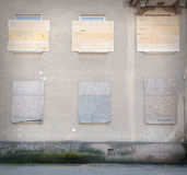 Old windows. Old nailed windows on the wall stock photography