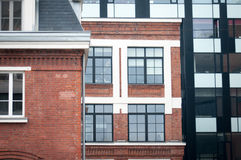 Old windows new ages. Old classical building renovated looking like a modern one royalty free stock photos