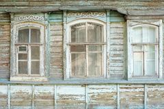 Old windows of obsolete wooden traditional Russian house. Royalty Free Stock Images