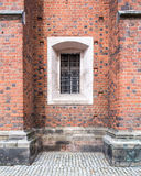 Old windows in red brick wall Stock Photo