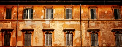 Old windows in a row. Old building facade with windows in row Royalty Free Stock Photos