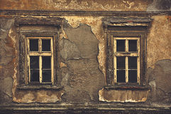 Old Windows on Ruined House Exterior Wall. Old Obsolete Windows on Ruined House Exterior Decayed Wall, Toned Image Stock Photography