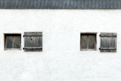 Old windows and shutters in an Austrian castle wall Stock Photos