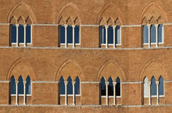 Old windows in Siena Stock Photography