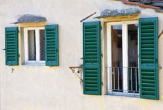Old windows on stucco wall Royalty Free Stock Images