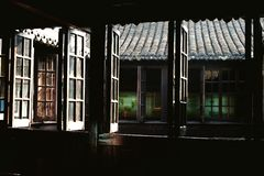 Old windows. Sunlight barely streams into a old musty chinese house Royalty Free Stock Photos