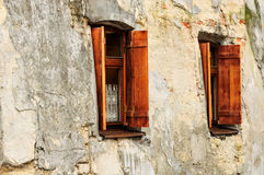 Old windows. Wooden window with shutters on old stone wall background royalty free stock image