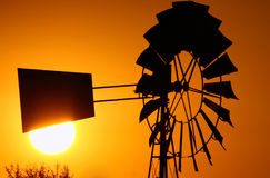 Old windpump. With sun directly behind stearer royalty free stock photo