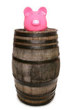 Old wine barrel and piggy bank Royalty Free Stock Photo