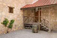 Old wine barrel used as water. In a garden of an old house stock image