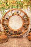 Old wine barrels, grapes, casks and bottles in wine-cellar royalty free stock photos