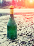 Old Wine Bottle Green Lies on the waterfront in the Sand Stock Image
