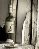 Old wine bottle in a old house. Old wine bottle in a old abandoned house Stock Image