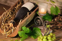 Old wine bottle on a tile with candle Royalty Free Stock Photos