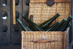 Old wine bottles in a basket Stock Photo