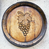 Old wine cask. With grape symbol royalty free stock photos
