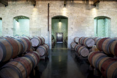 Old wine Cellar in Bordeaux, France. Ancient wine cellear with oak barrels in Bordeaux, France stock photography