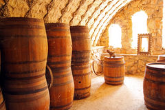 Old wine cellar with wooden barrels Royalty Free Stock Images