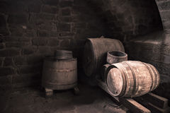 Old wine cellar and wooden barrels Stock Photos