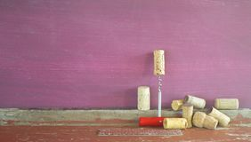 Old wine corks and a cork screw. Panoramic, free copy space Royalty Free Stock Photo