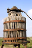 Old wine press. Old italian wooden wine press for pressing grapes yo produce wine Stock Photography
